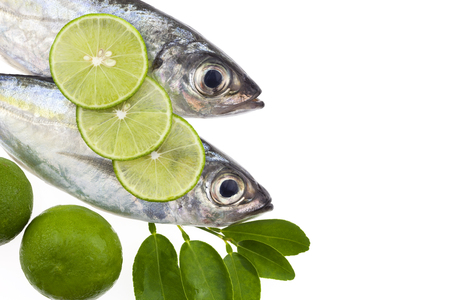fish tail: Selar crumenophthalmus ,Bigeye scad ,fish with lemon and leaf isolated on white background,concept cooking background Stock Photo