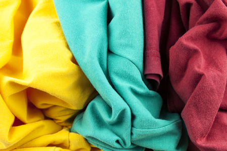 messy clothes: yellow,green,red t-shirt colorful clothing, abstract background