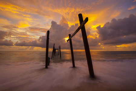 Beautiful sunset with old wooden bridge at Khao Pilai in Phang- Nga Thailand Stock Photo