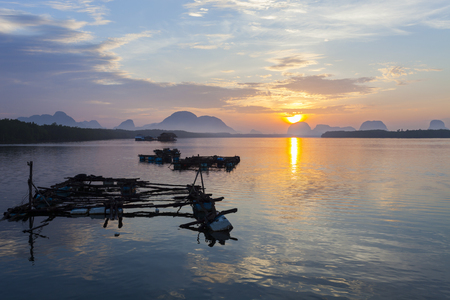 Beautiful morning sunrise over sea and mountain in phang - nga thailand