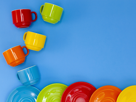cup four: colorful four coffee cups on blue background Stock Photo