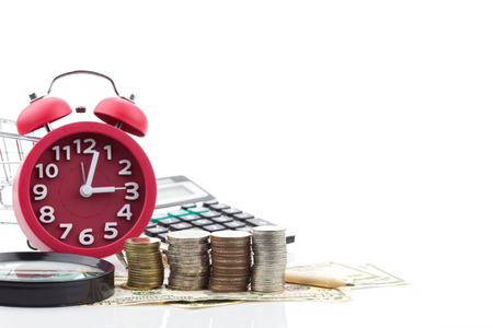 Red alarm clock and Calculator on money banknotes Euro and Dollars,concept of business planning and finance