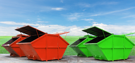 Colorful Industrial Waste Bin (dumpster) for municipal waste or industrial waste on green grass and blue sky background,with ecology concept