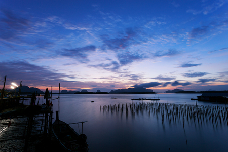 First morning sunrise light of year 2018 at coastal fishing village ,Beautiful scenery morning sunrise over sea and mountain in phang - nga thailand. Stock Photo