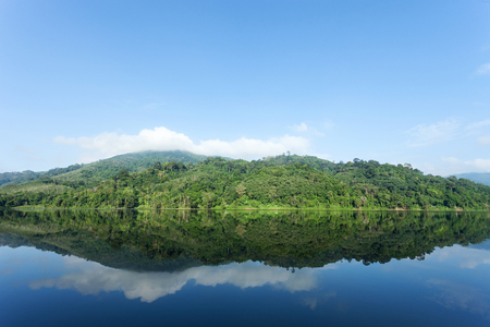 Mountain and Lake with reflex in the water scenery beautiful view with blue sky and clouds in phuket thailand