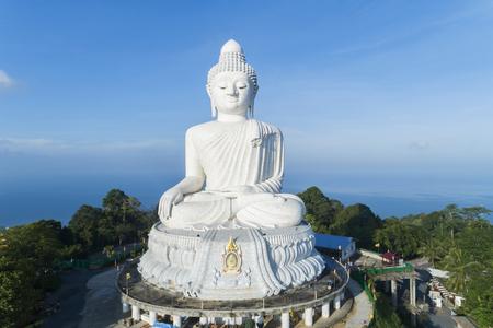 Big buddha over high mountain in Phuket thailand Aerial view drone shot.