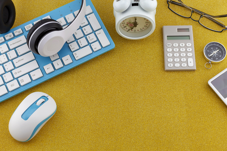 Business objects of Keyboard ,mouse ,Headphone with white alarm clock,compass and calculator on gold glitter texture sparkling shiny paper background.