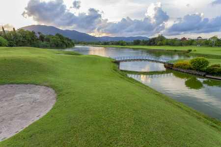 Golf course green grass field and lagoon. Imagens