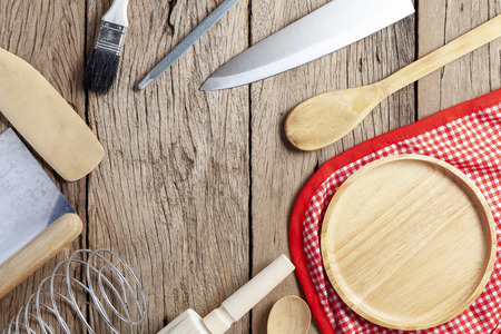 Set of wooden spoon,fork,knife, on old wooden table background,top view copy space for your product and cooking design.