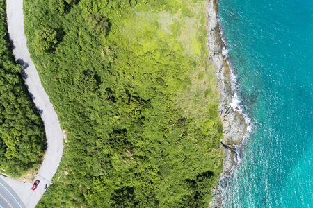 Asphalt rural road curve on high mountain with tropical sea image by Drone aerial view Top down.