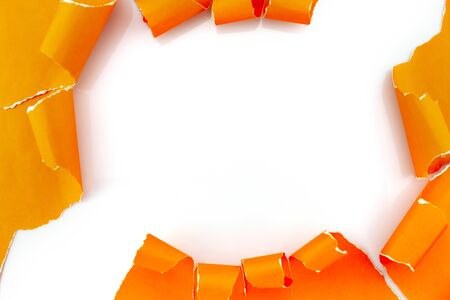 Ripped torn orange paper on white background. 스톡 콘텐츠