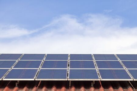 Solar panel and solar energy panel on red roof blue sky and sunlight Ecology concept.