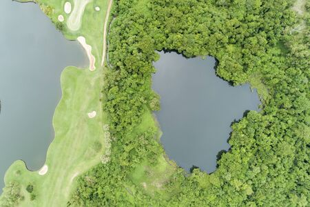 Aerial view drone Top down shot of beautiful green golf field High angle view in summer time.