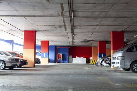 Parking garage interior , underground interior with parked cars.