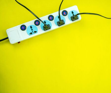 Electric power socket and plug on yellow paper background