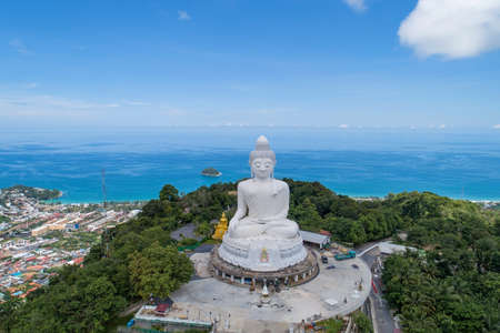 Vesak day background concept of Big buddha over high mountain in Phuket thailand Aerial view drone camera shoot.