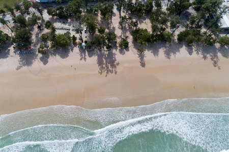 Aerial view sandy beach and crashing waves on sandy shore Beautiful tropical sea in the morning summer season image by Aerial view drone shot, high angle view Top down