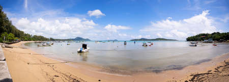 Tropical beach panorama with LongTail boats in the sea blue sky and white clouds in summer season