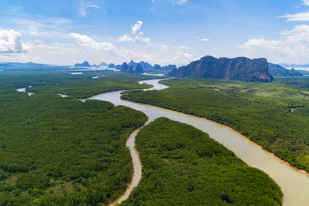 Aerial view drone shot amazing landscape of beautiful natural scenery river in mangrove forest and high mountains in phang nga province Thailand