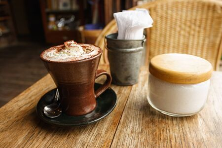 A cup of hot chocolate with whipped cream