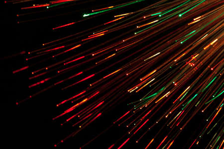bunch of optical fibres dinamic flying from deep on technology background Stock Photo - 17337760