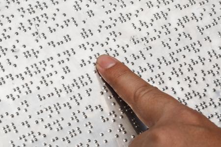 braile: Lectura Braille Foto de archivo