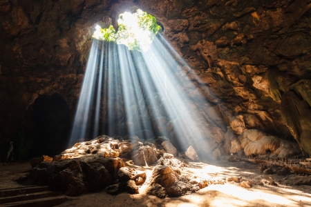 caverns: Sun beam in cave  Stock Photo