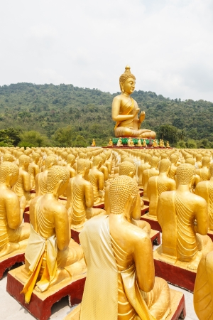 disciples: Buddha with 1250 disciples statue Stock Photo