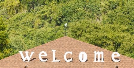 welcom: welcom sign on roof Stock Photo