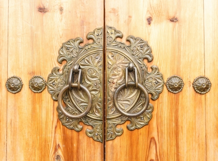ancient door knocker on a wooden door