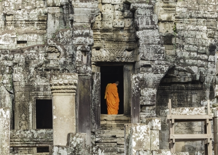 passageways: Monks walk through passageways at Angkor wat, Cambodia