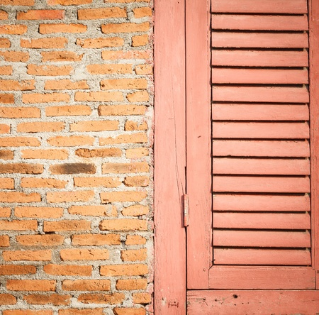 Close up wooden door and brick wall photo