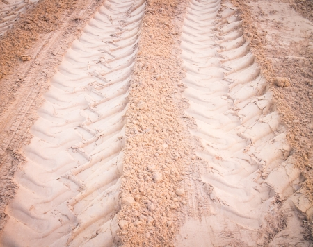 wheel tracks on dirt photo