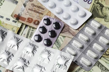antidepressant: pills and money Stock Photo