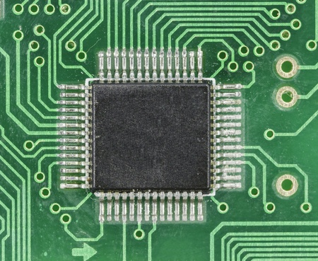 Old green circuit board close up photo