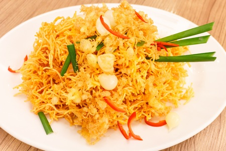 crispy Thai rice noodles and sweet and sour sauce photo