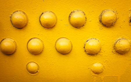 solidity: yellow metal background with rivets