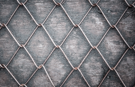 Wire Mesh Fence on wood photo