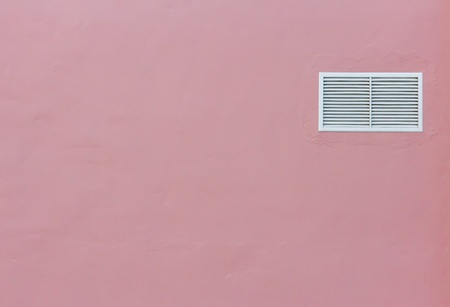 louvered: A little louvered white window on wall Stock Photo
