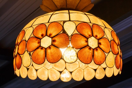 Lamp shade decorated with shells photo