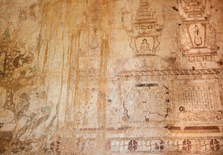 Painting buddha on cave walls,Myanmar
