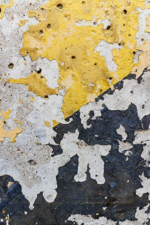 Yellow and black peel off from the surface of the plaster