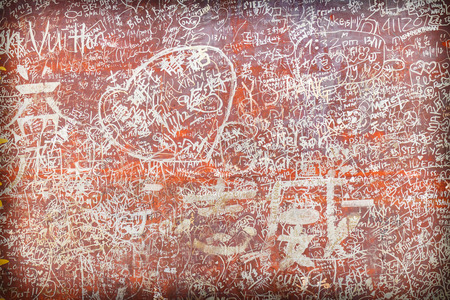 defaced: Lots of Love Carvings Initials Symbols Tags on Old Wall