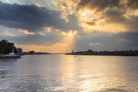 Beautiful sunset beams over the river Stock Photo