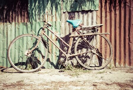 Old rusty vintage bicycle Stock Photo