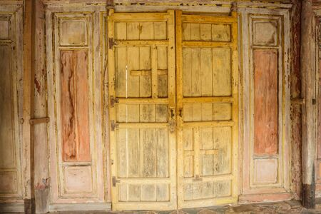 Detail of a closed wooden door