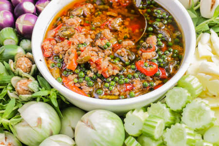 Thai cuisine chili paste mixes with fish serves with various vegetables Stock Photo