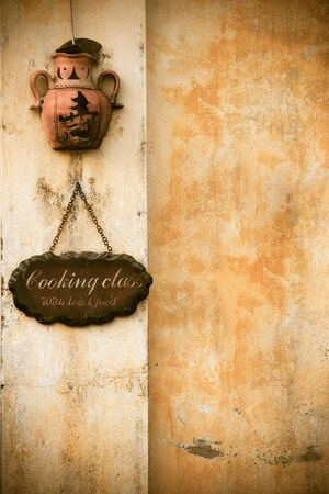 Cooking school text on wooden cutting board