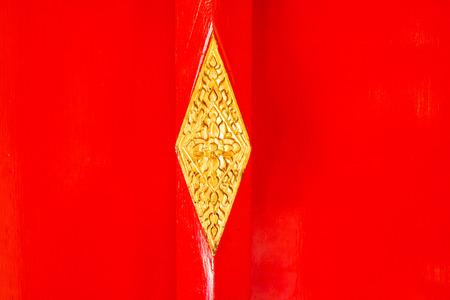 Detail of  red wooden door