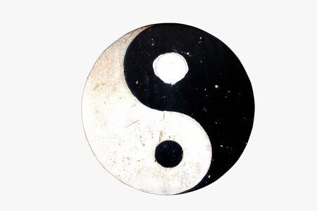 Isolate Yin Yang symbol on old metal plates on white background with clipping path.